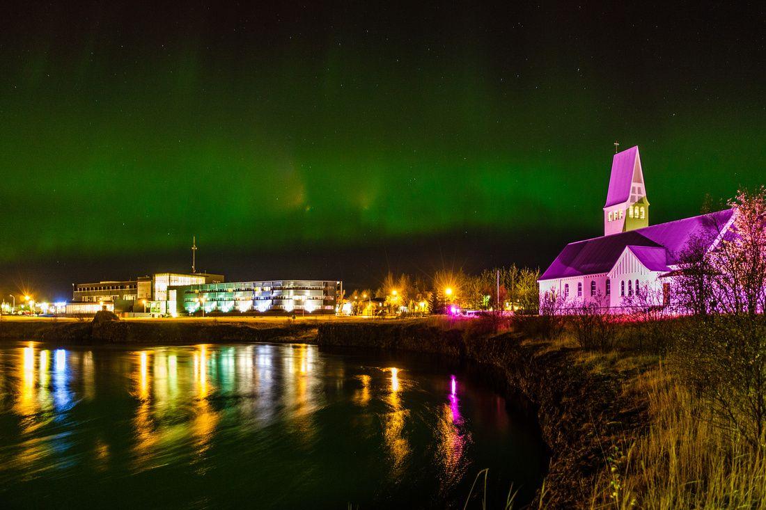 Selfoss church and hotel selfoss undir the northern lights