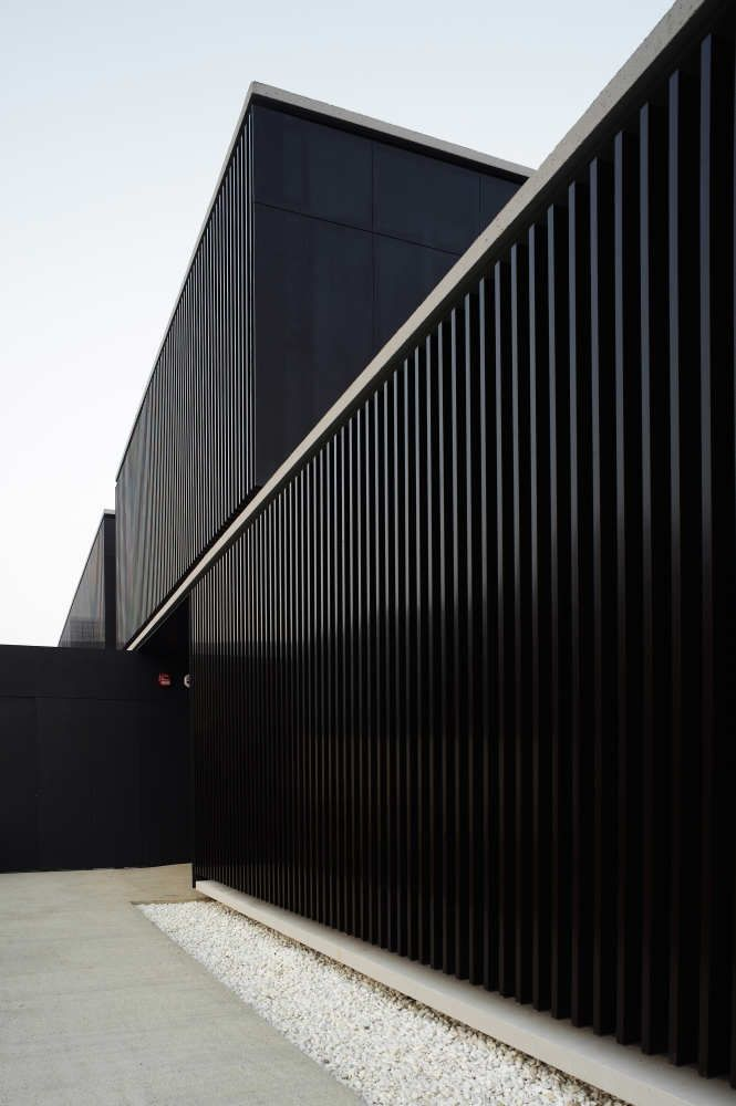 Black facade. Shelter Home for the Homeless by Javier Larraz.