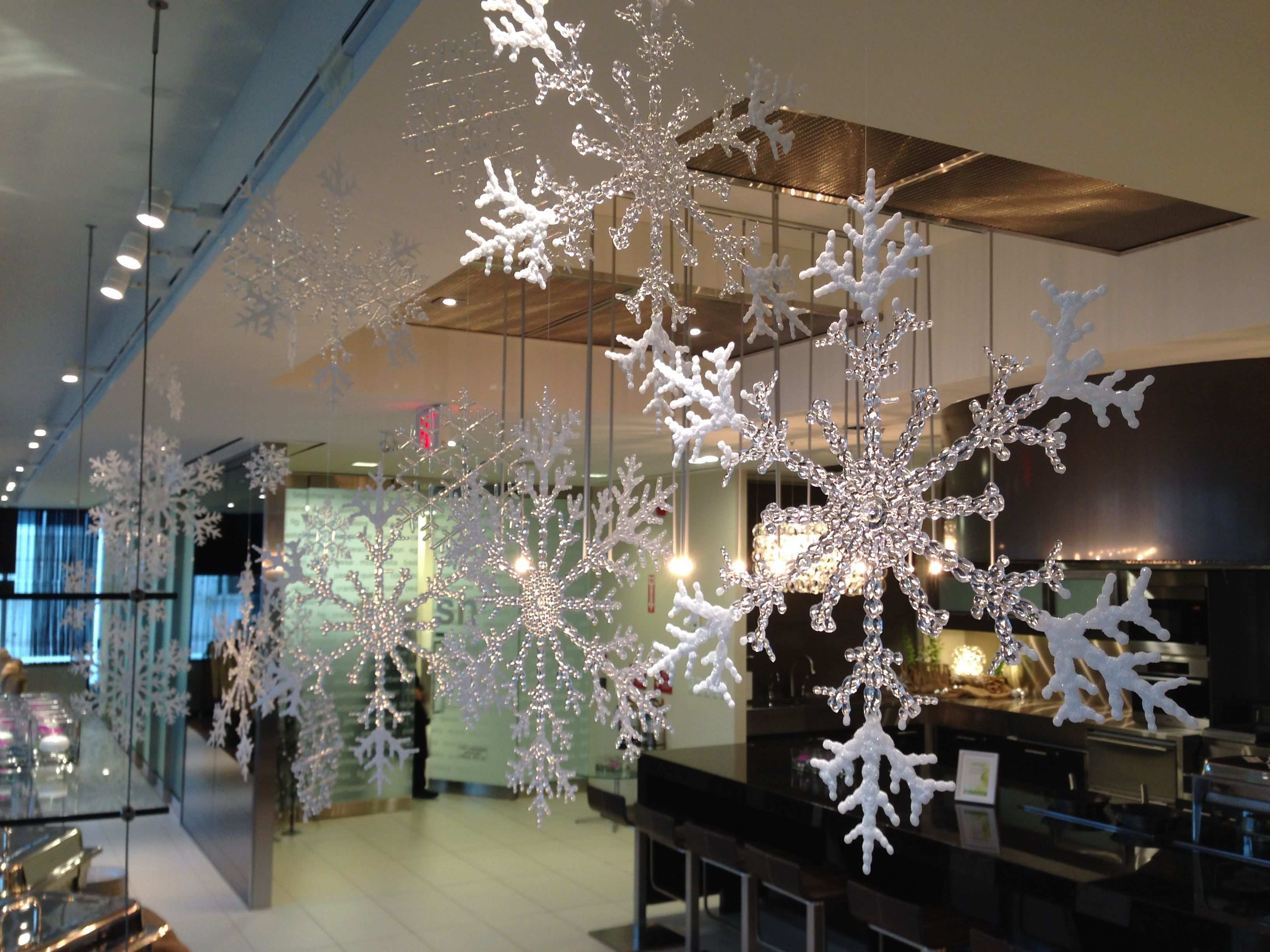 Hang Different Sized Snowflakes With Fishing Line For A
