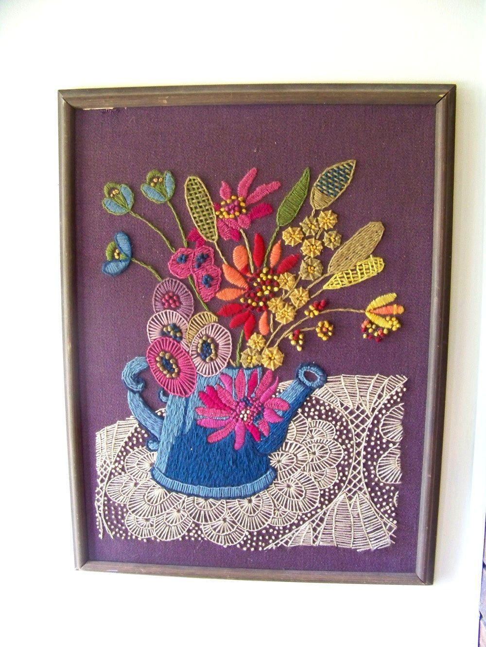 Large vintage crewel embroidery watering can with flowers on
