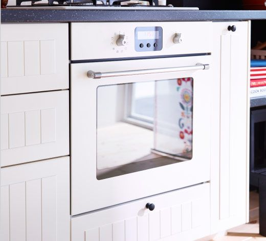 Off White Traditional Style Oven Installed Under Dark