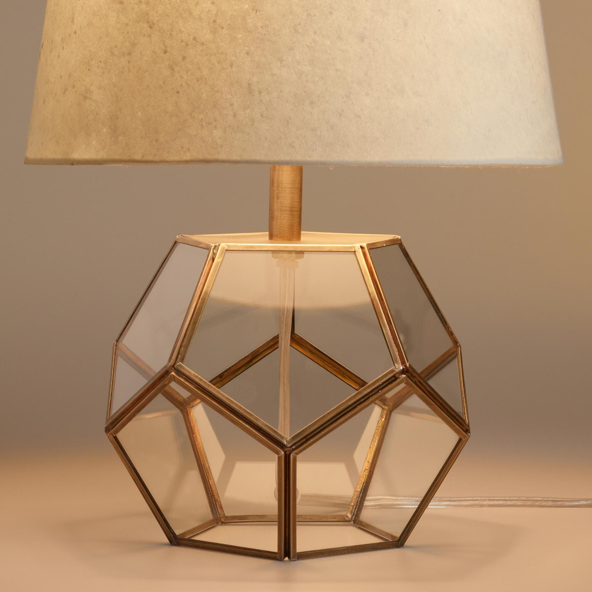 With precision cut glass panes fitted to an antique brass finish with precision cut glass panes fitted to an antique brass finish frame our exclusive hexagon table lamp brings geometric flair to the table mozeypictures Gallery