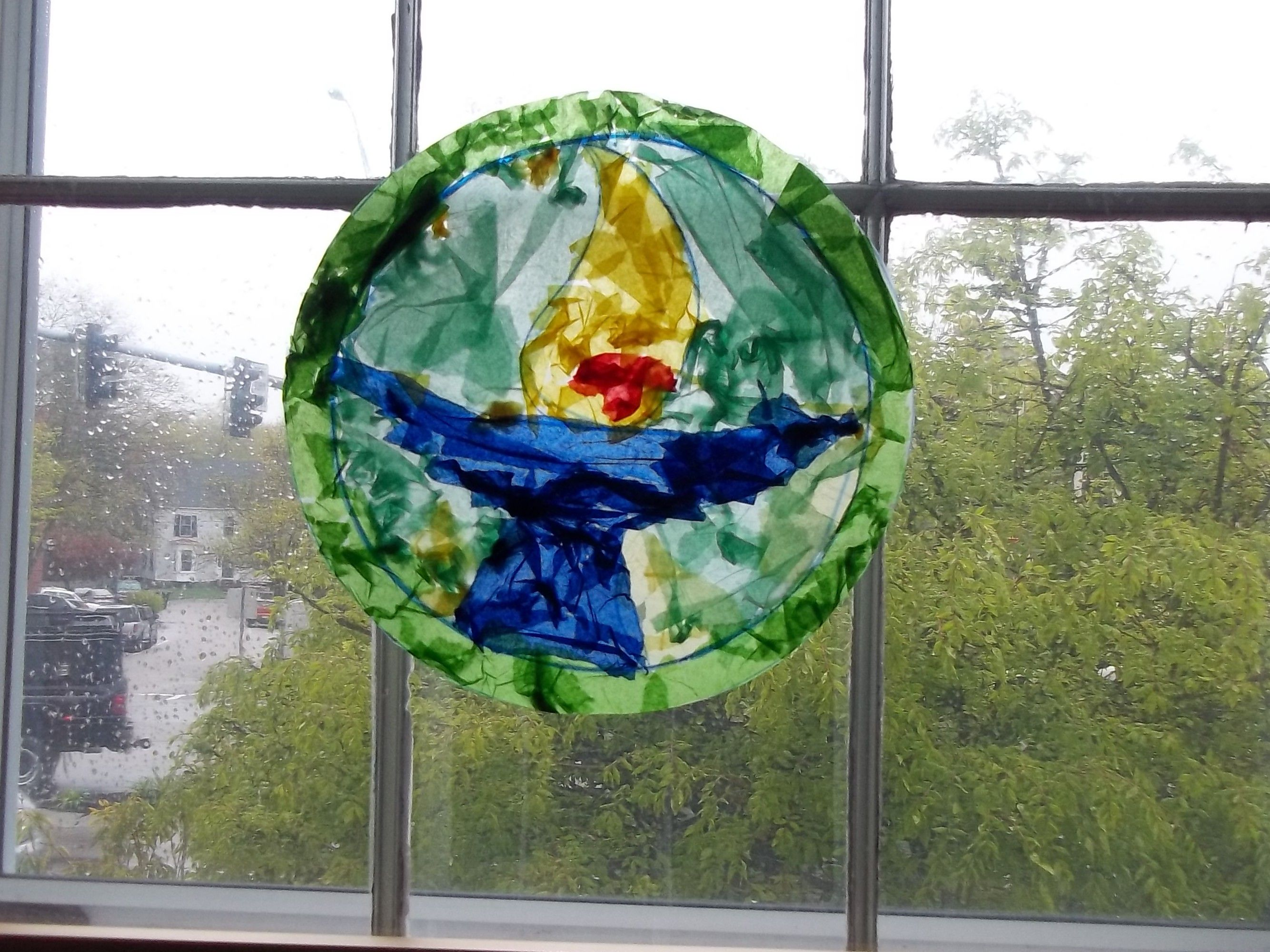 """""""Stained Glass"""" UU Chalice made with tissue paper and clear contact paper. The outline was drawn ahead of time and tissue paper was applied by a group of 4-8 year old children. Fun and easy."""
