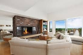 Image result for fireplace dividing two rooms Dividing wall