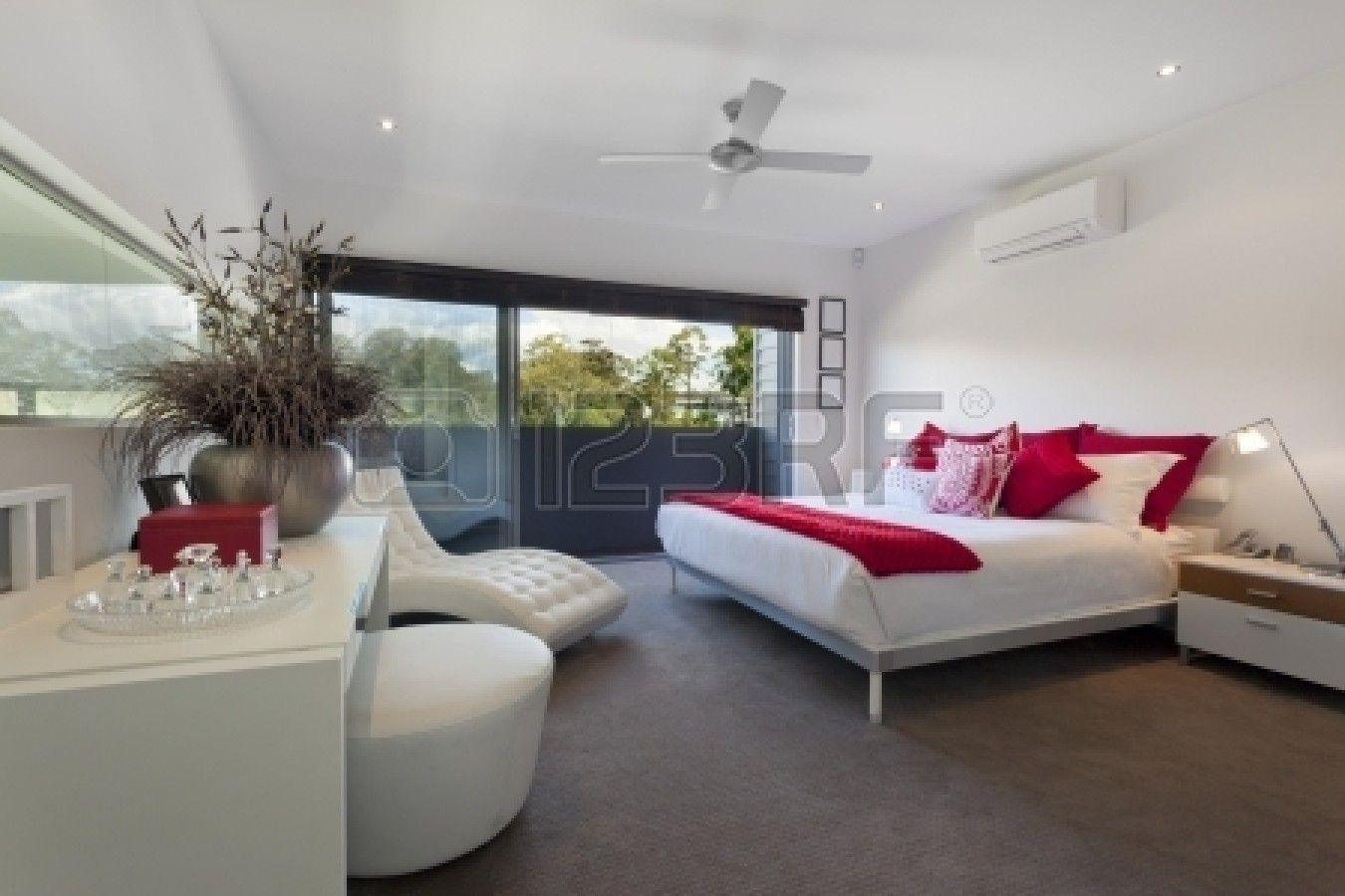 Stylish master bedroom in luxury Australian mansion