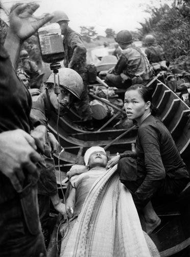 Al Chang 1962 South Vietnamese medics tend to a captured Viet Cong guerrilla, Vietnam