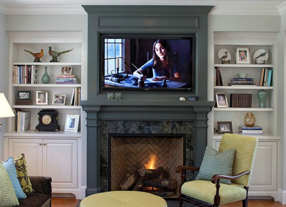 Clever TV Placement About The Fireplace