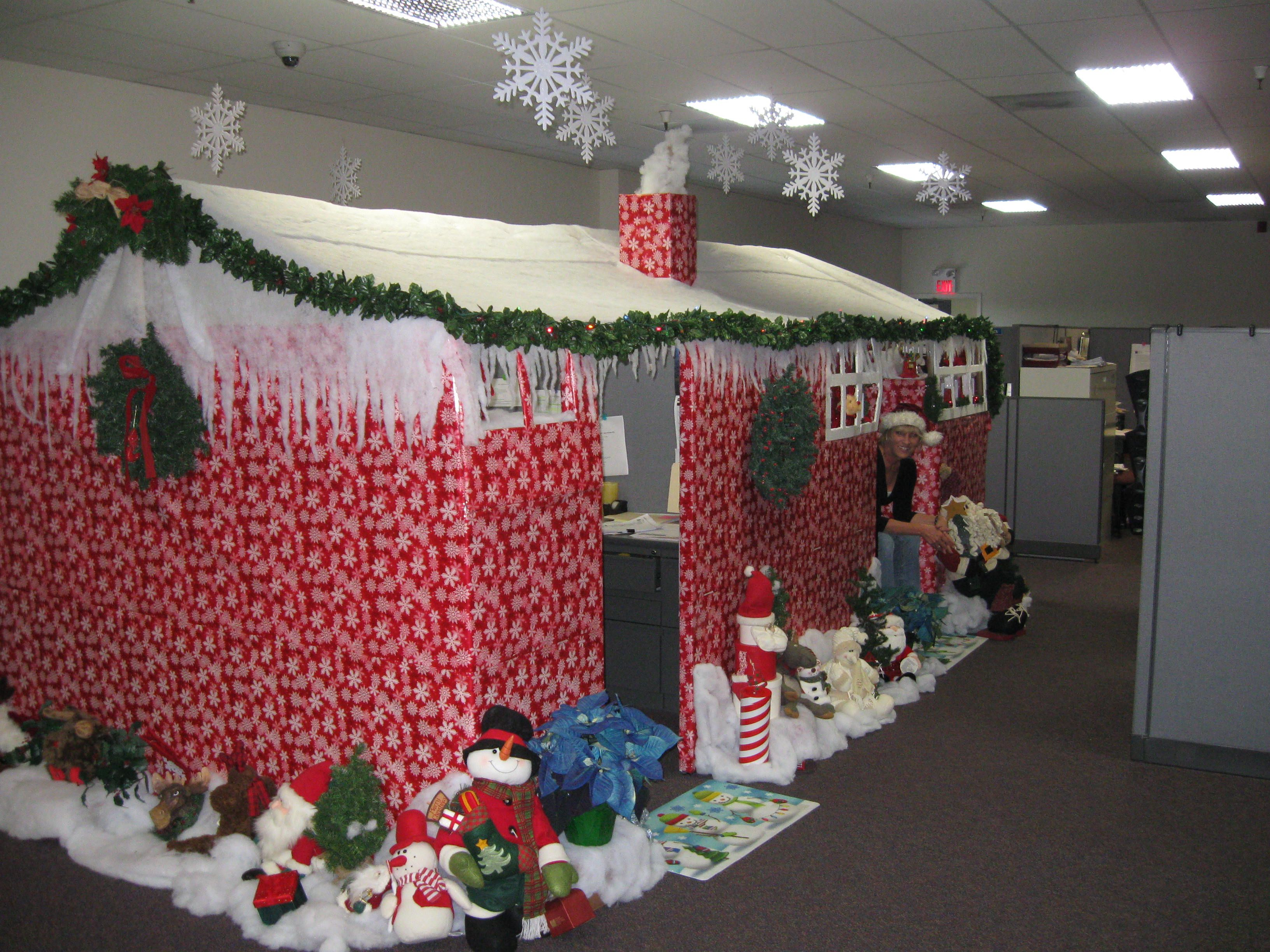 2 cubicles at work decorated for christmas
