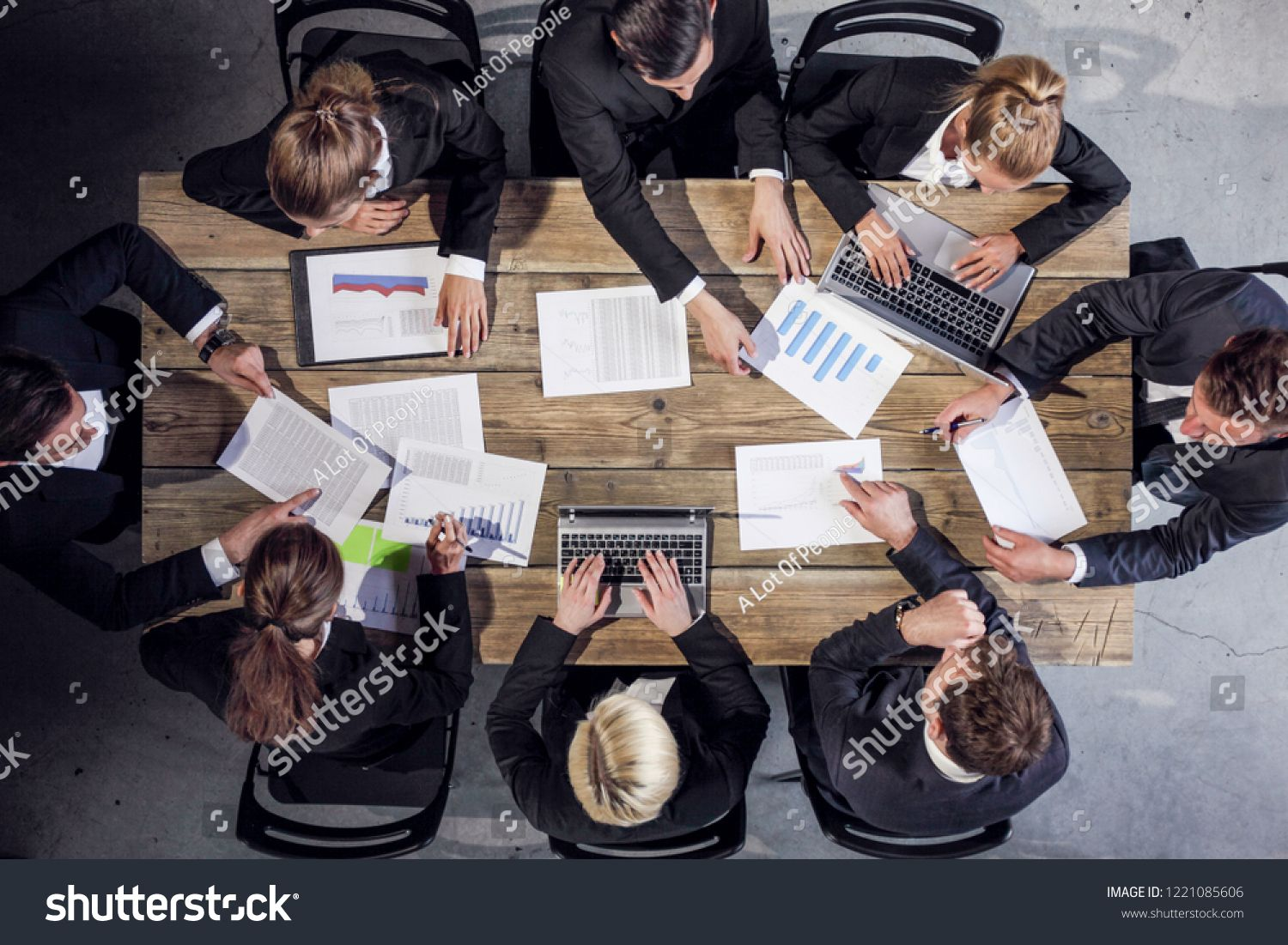Business People Analyzing Financial Documents Showing Income Charts And Graphs Teamwork Conce Financial Documents Business People Professional Business Cards