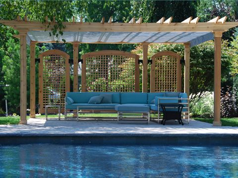nice pergola with wooden privacy screens in the back and a sunfx