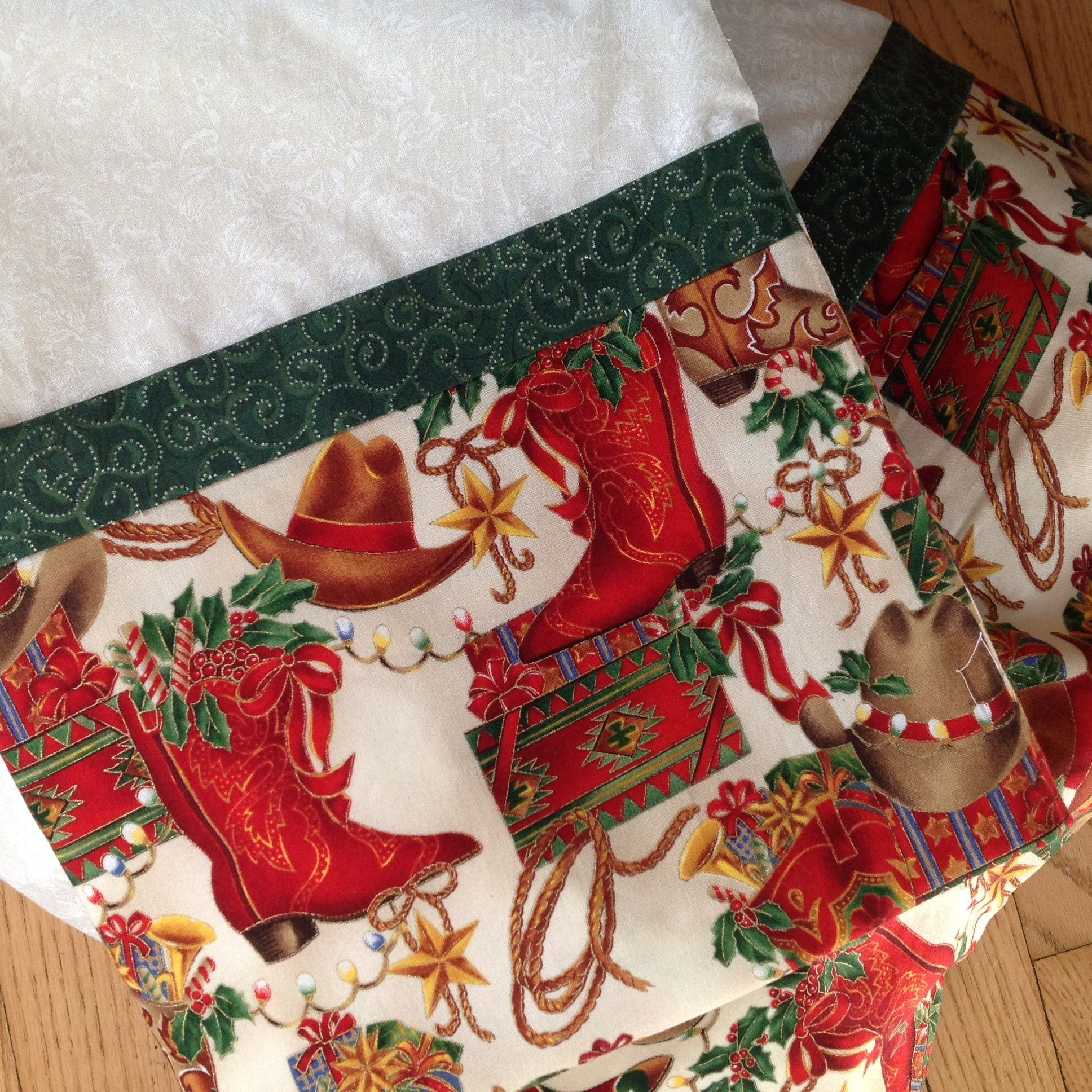 Cowgirl cowboy Christmas pillowcases, red boots, brown hats, greens ...
