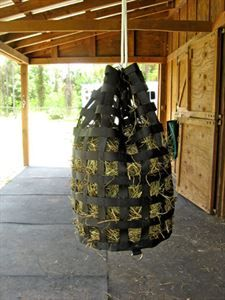 Picture Of The Nibblenet Nibble Go Round Slow Feed Hay Bag Black