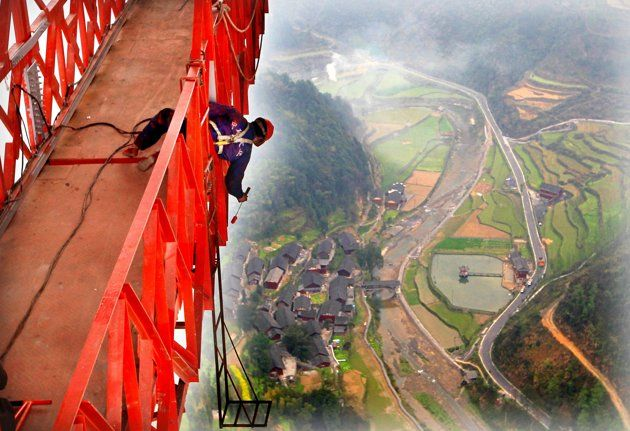 The Aizhai suspension bridge in China was just completed; it's over 1000 feet from the valley floor. Just looking at this picture makes me nauseous.