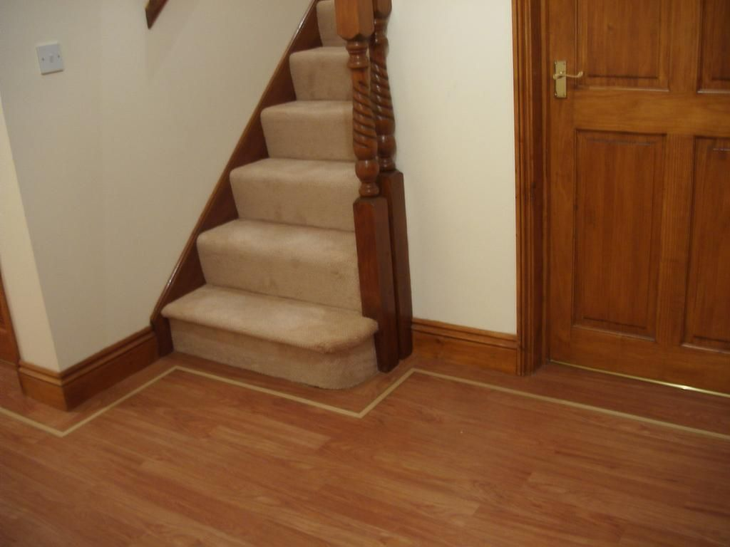 Wood flooring on stairs with carpet visit wood railing for Hard laminate flooring