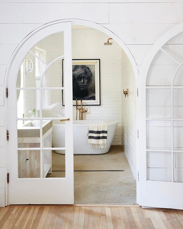 Farm House Bathroom With Arched French Doors And Giant Soaker Tub