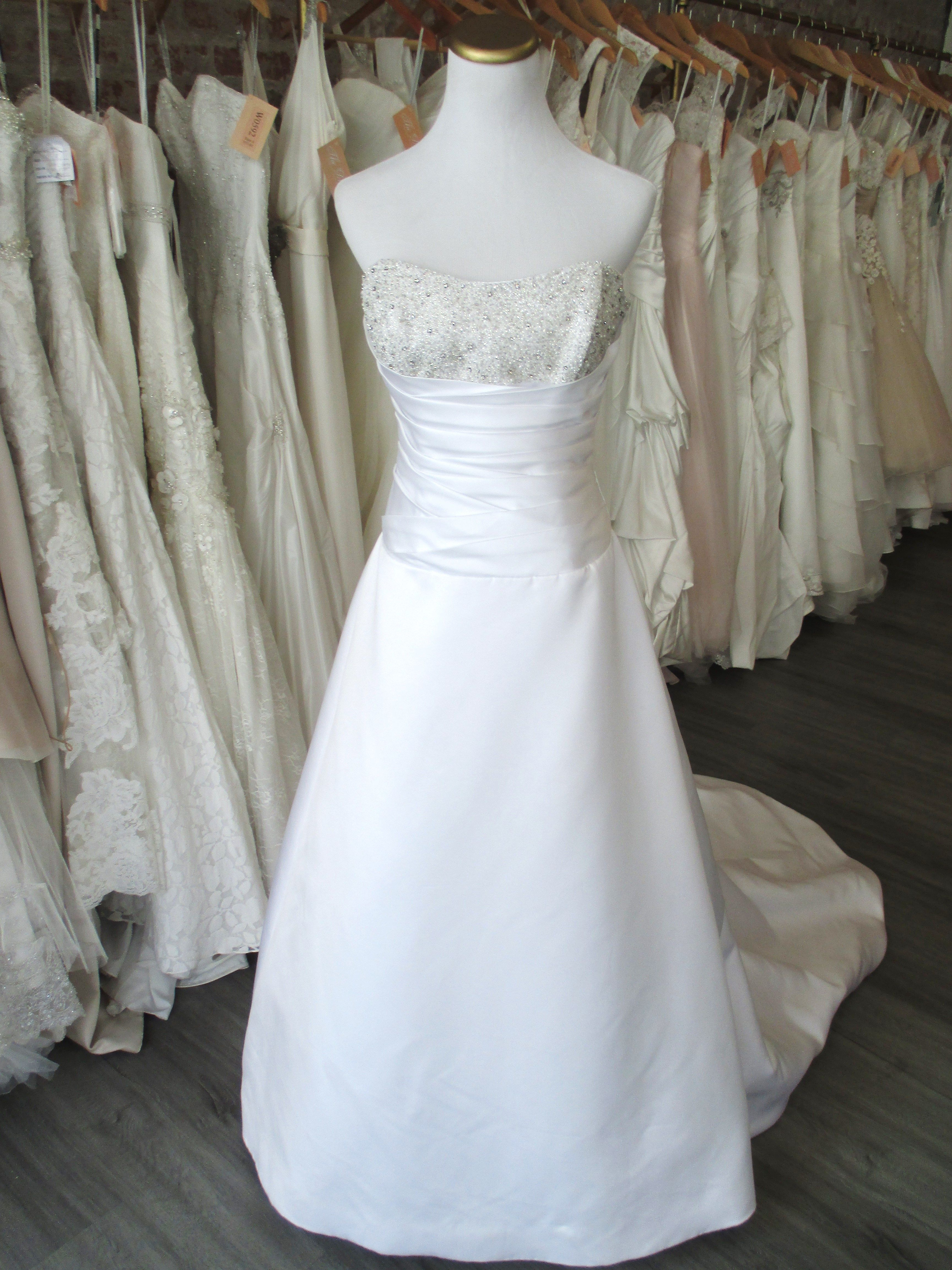 White and silver wedding dresses  This white dress by Bride  Be is a size  aline silhouette