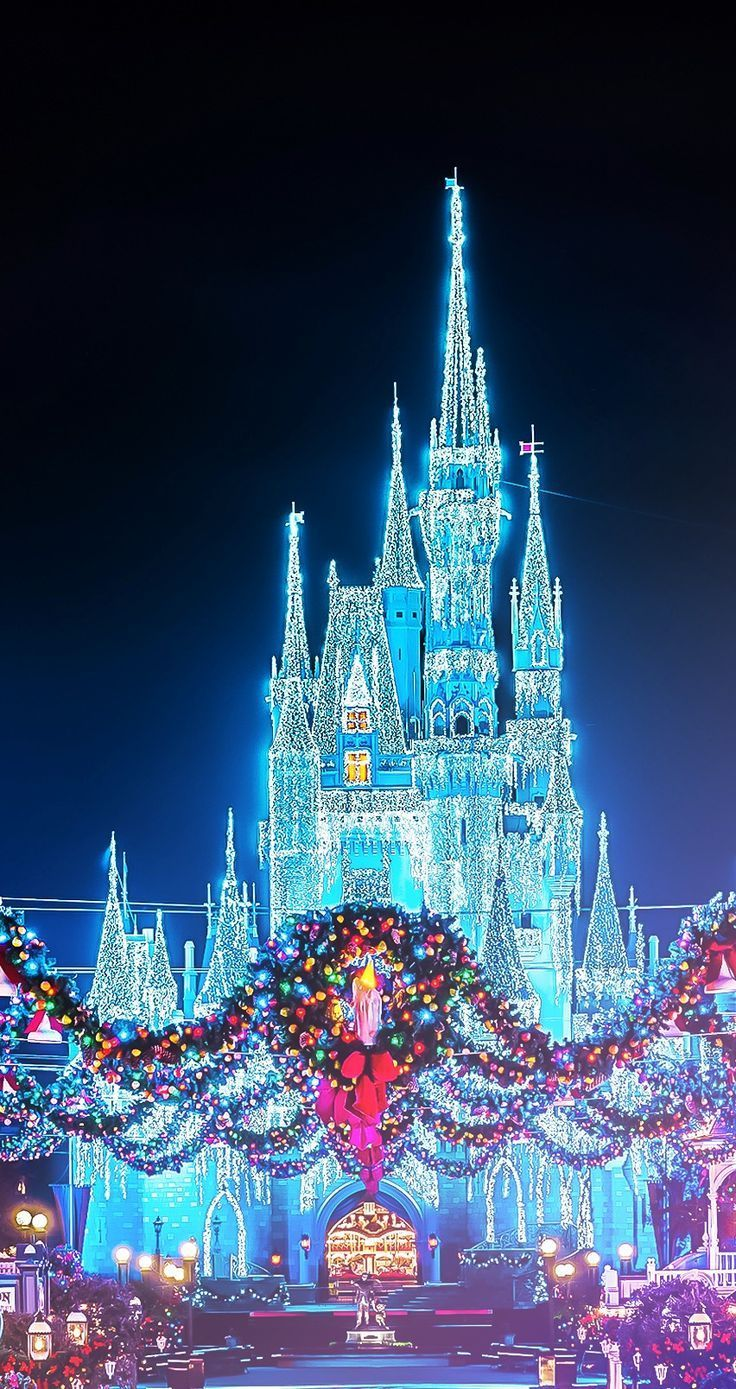 Christmas disney magic kingdom castle with the wreaths christmas disney magic kingdom castle with the wreaths photographer unknown have a wonderful christmas voltagebd Images