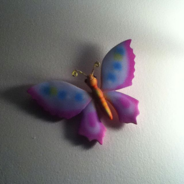 Hang a butterfly on nail! Looks cute!