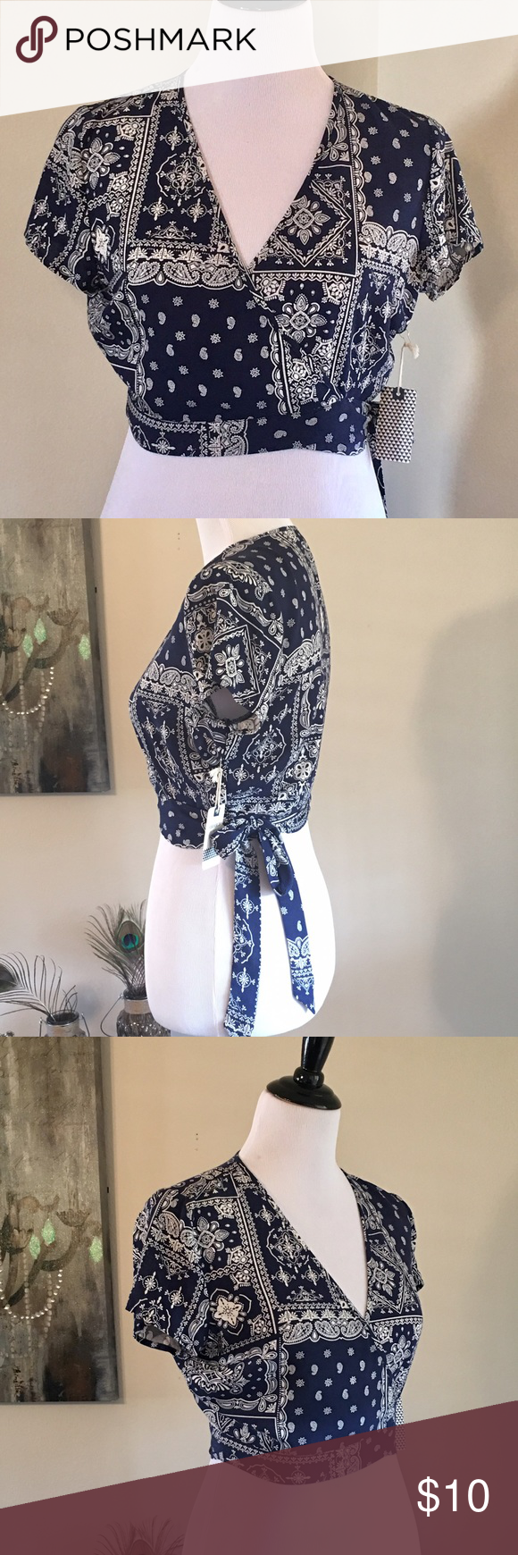 Bandana Print Wrap Around Top New with tag. Size Medium. 100% Rayon. Old school wrap around style. Love how the bow hangs down the side. Criss cross front. Classic navy bandana print Forever 21 Tops Blouses