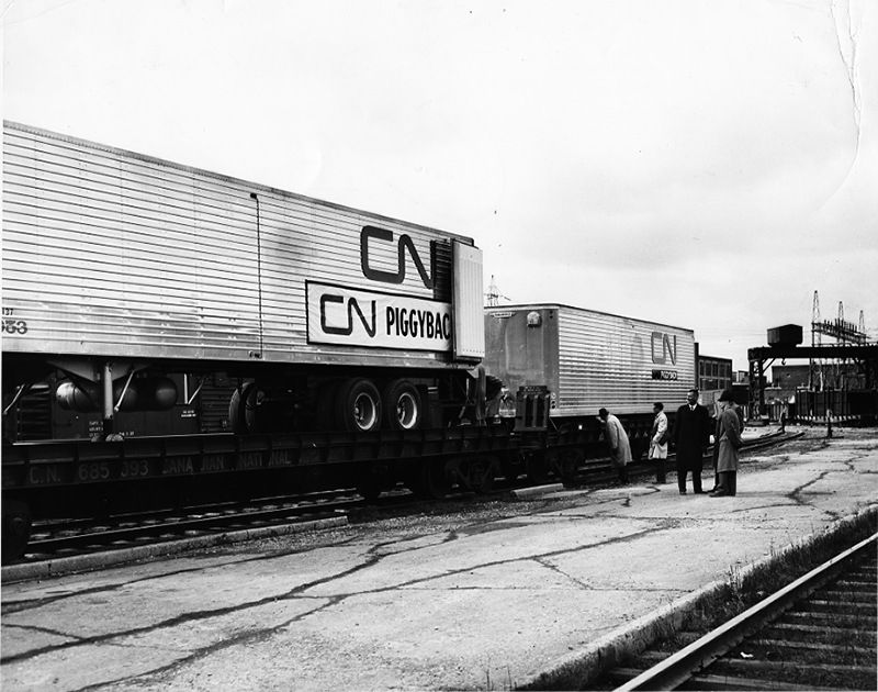 Description Image of two CN semitrailers piggybacking on