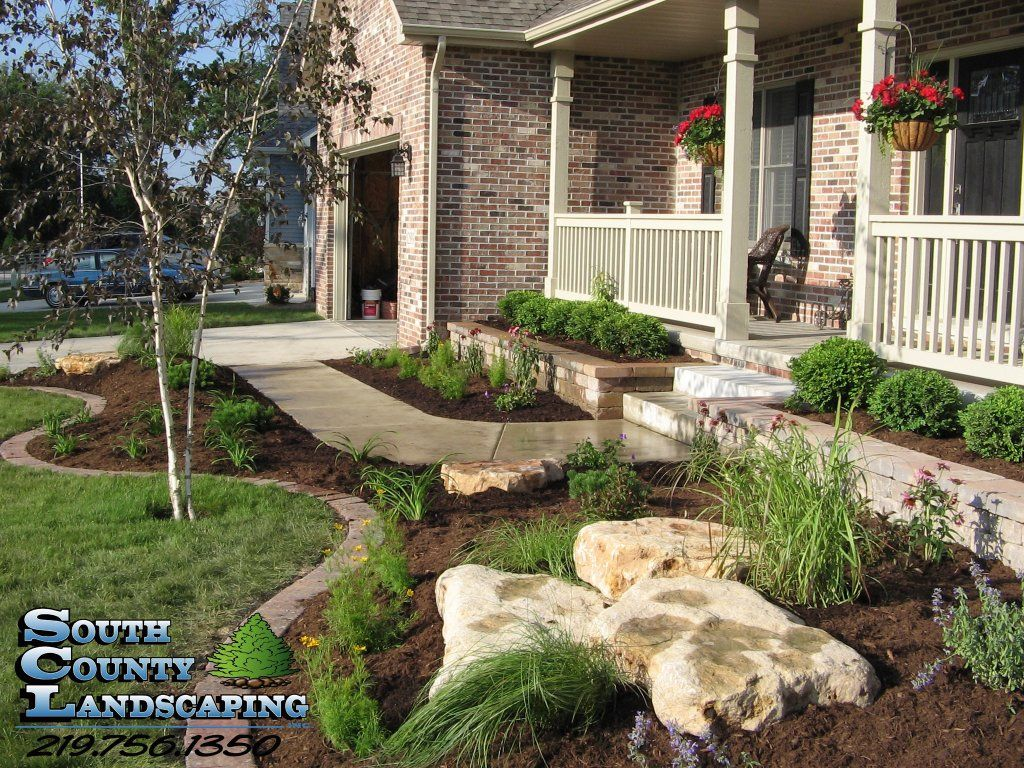 Low maintenance landscaping with boulders once the plants for Plants that require no maintenance