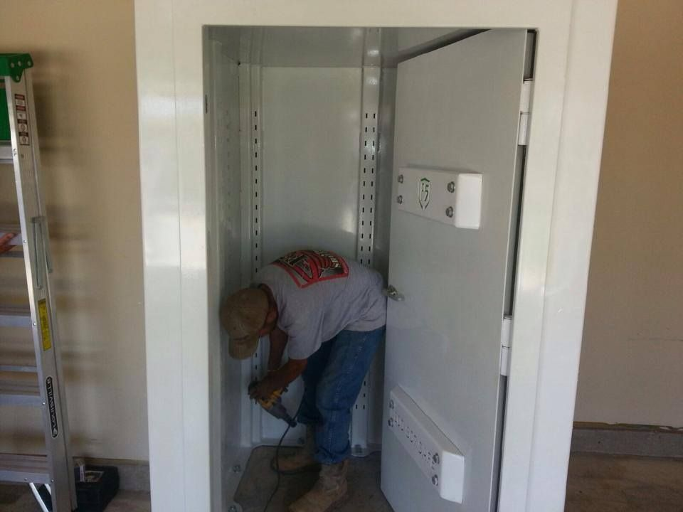 An F5 Storm Shelters Installer Finishing Up A Safe Room