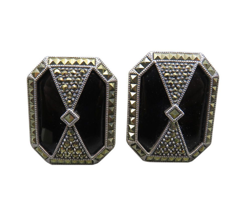 For a polished finish pair Judith Jack's sophisticated geometric onyx earrings featuring marcasite accents and gold wash finish with your outfit to complete a classic look.