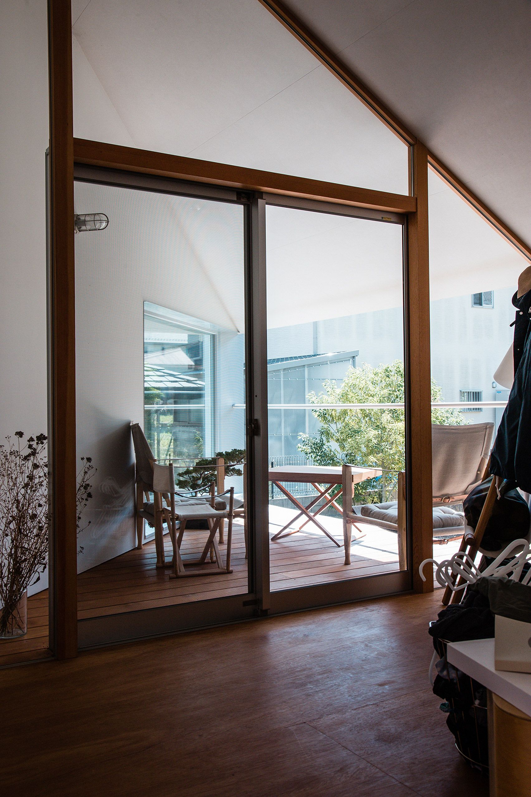 Huge Sliding Door Reveals Courtyard At House In Soe By Tato Architects