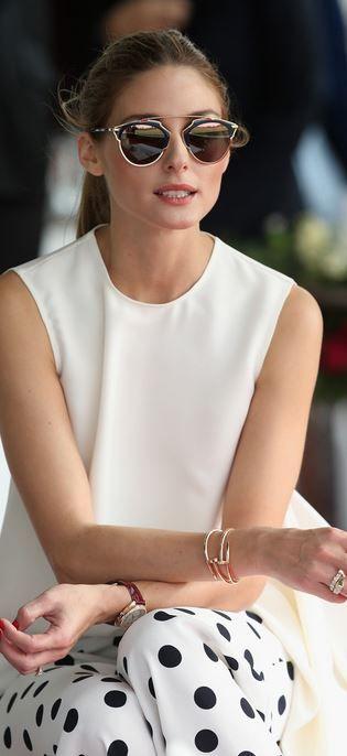 957e6dfbbe7b Olivia Palermo  Shirt and pants – CH Carolina Herrera Bracelet and watch –  Cartier Sunglasses – Dior