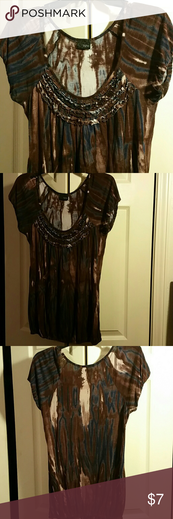 Beautiful Daytrip top Beautiful top from Daytrip. Tye dyed look I'd colors of dark blue, brown and cream. Cute ruffles at the necklone. Elastic at sleeves and hem. It's a little faded but still has a lot of life left in it. Daytrip Tops