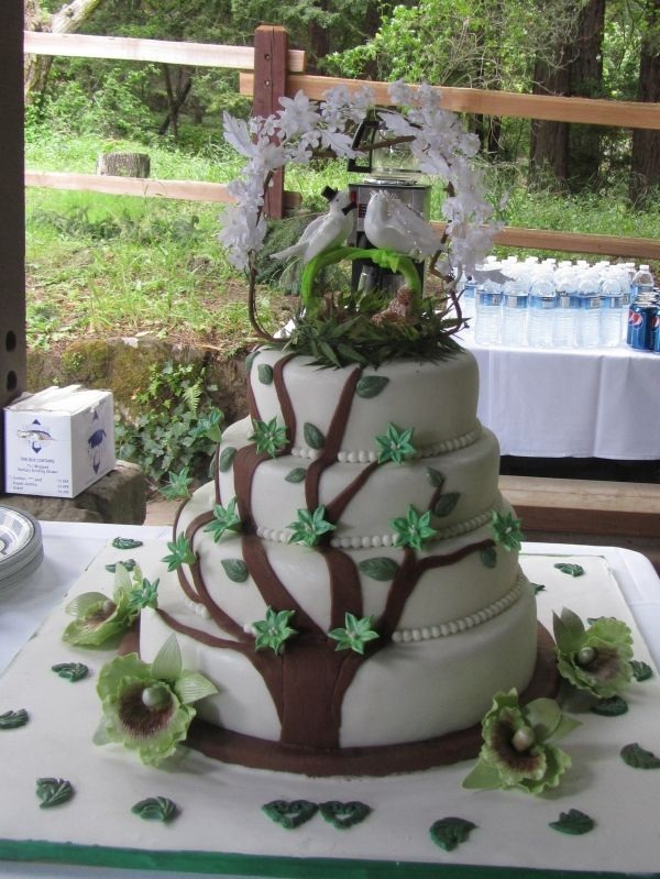 Tree branch wedding cake surrounded by orchid, so pretty.