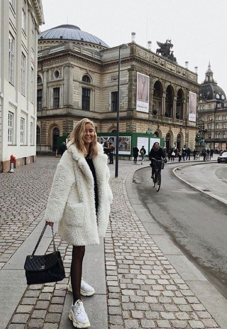 white chunky sneakers and white fur coat. fall and winter street style || best fashion for fall and winter; cold weather style #vacationoutfits