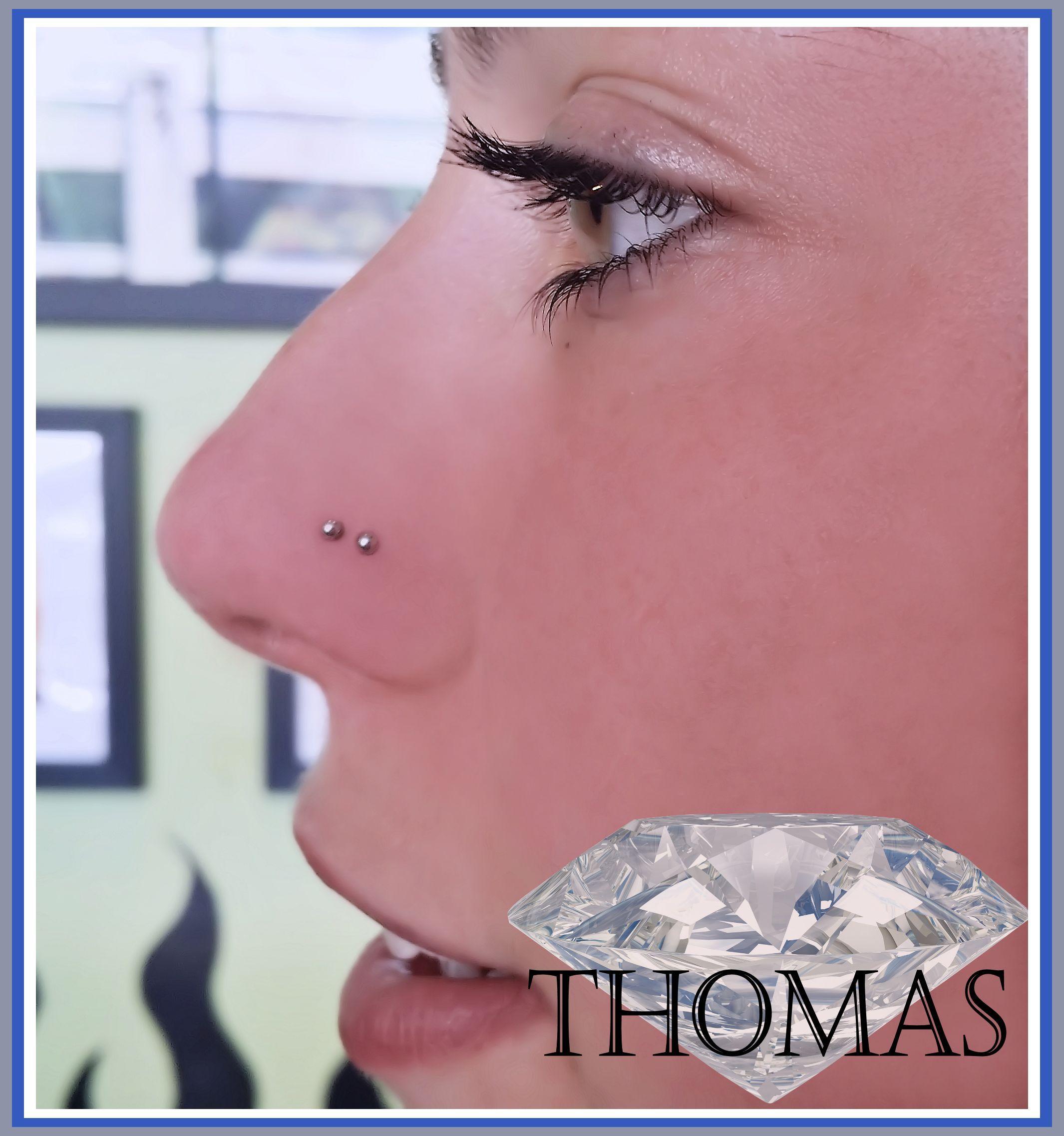 Two nose piercing  double nose piercing with steel studs   Piercings y más piercings
