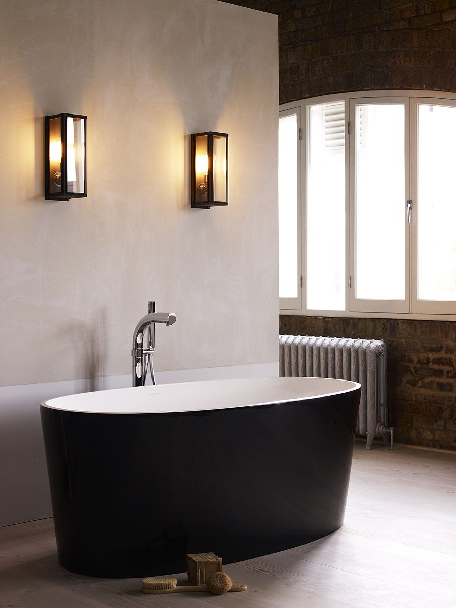 Industrial-style box wall lights in the bathroom are ...