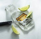 Corona bottle lime cutting tray. Recycled glass corona bottle, fused and formed into this handy lime cutting tray or spoon rest. $12