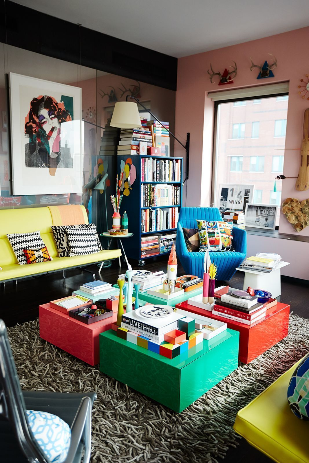 The Bright Colors Used In The Coffee Tables And The Couches Make