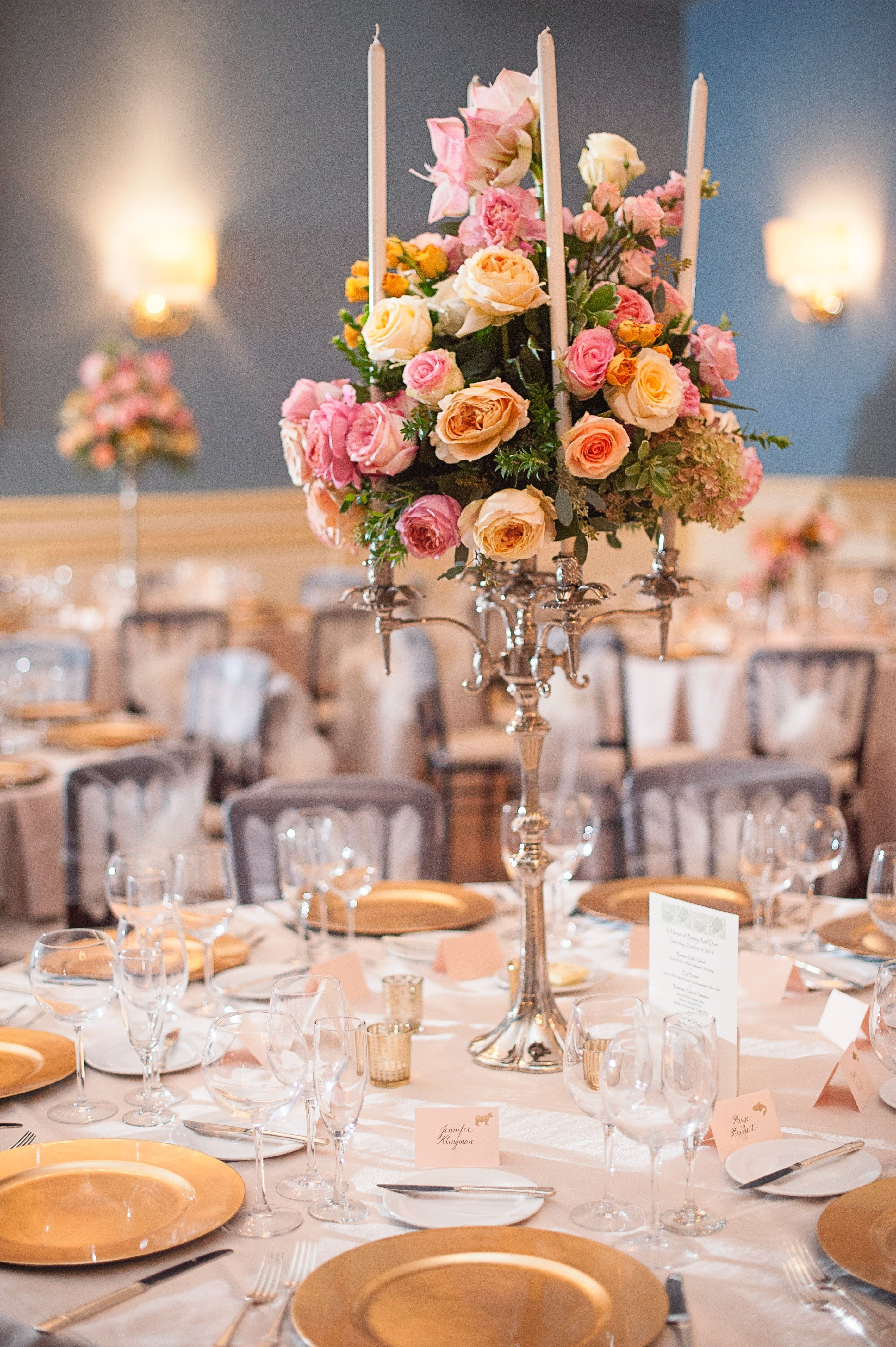 Candelabra Centerpieces With Pink Peach And Yellow Flowers