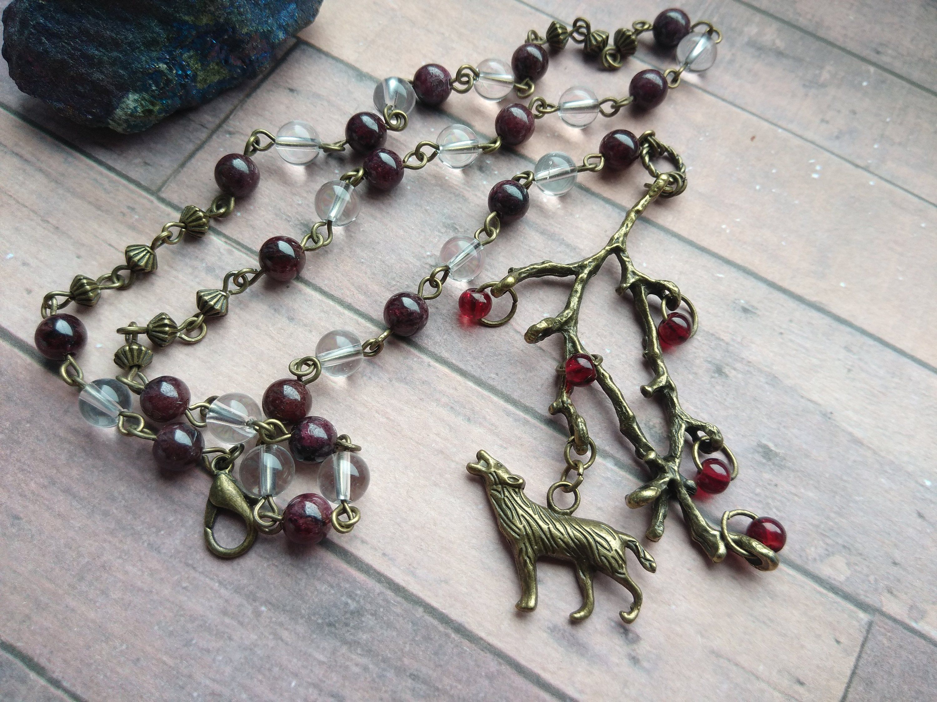 Howling wolf in the forest rosary, strength, passion and