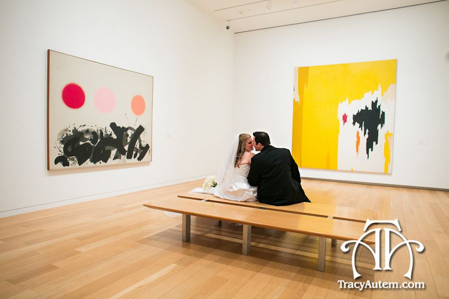 Modern wedding photography inside the gallery of an art museum.  LOVE this picture of the bride and groom by famous paintings.