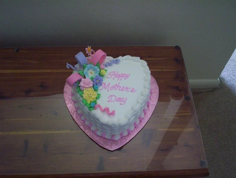 Mother's Day cake - The bow part is fondant, the flowers are made of royal icing.