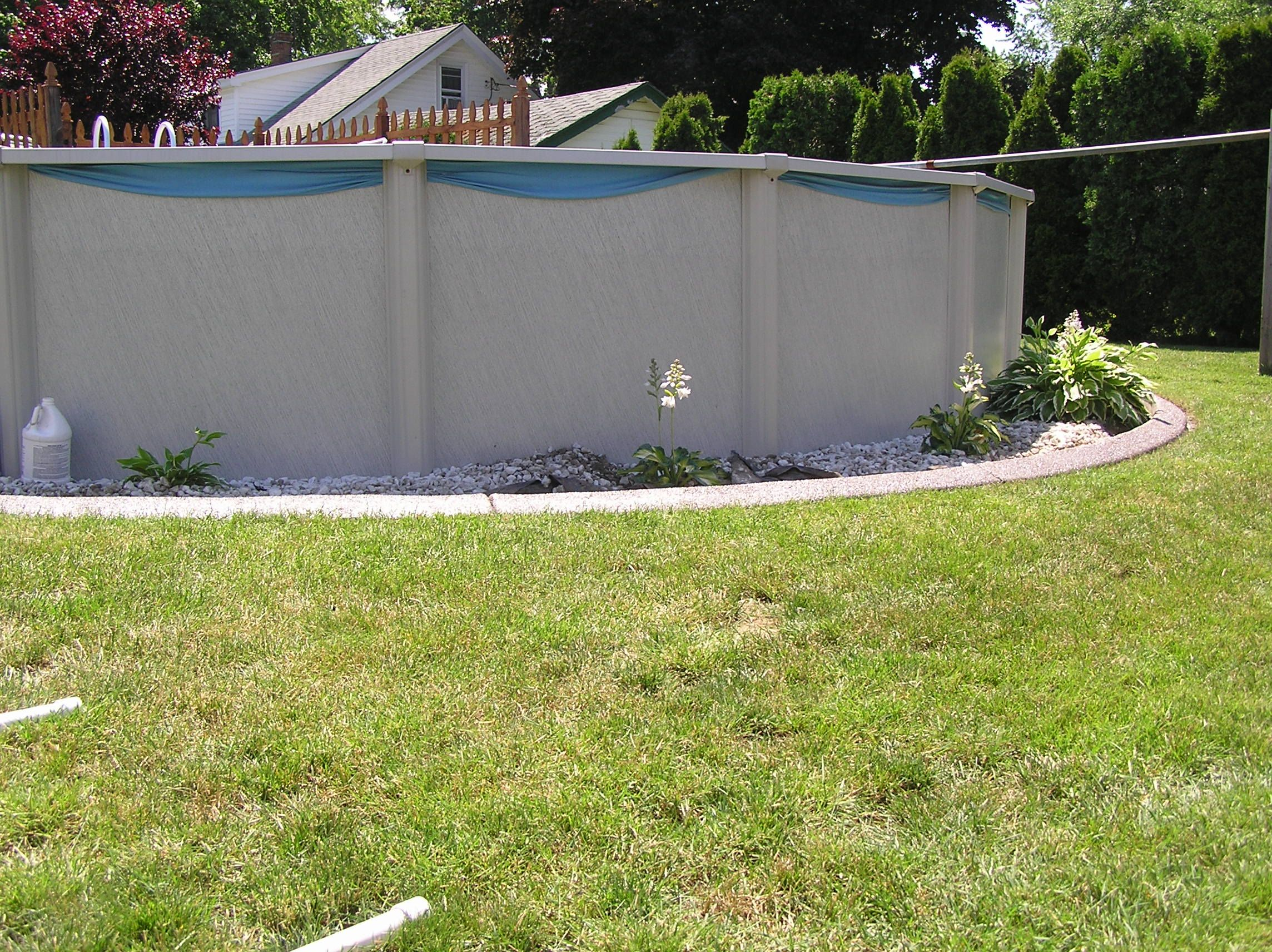 Landscape around above ground pool | Love my curbing! It has ...