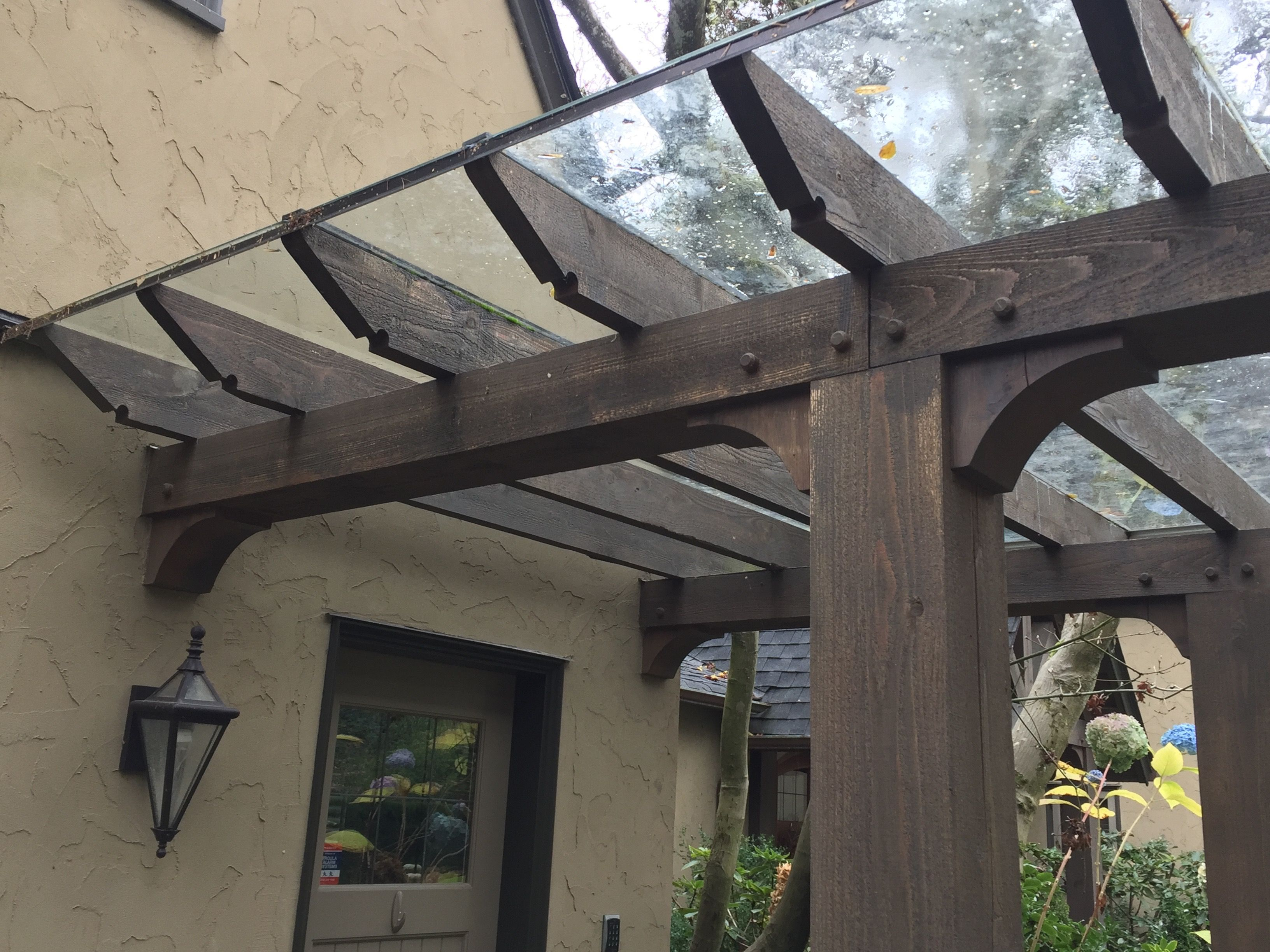 Glass With Metal Edge As Pergola Cover