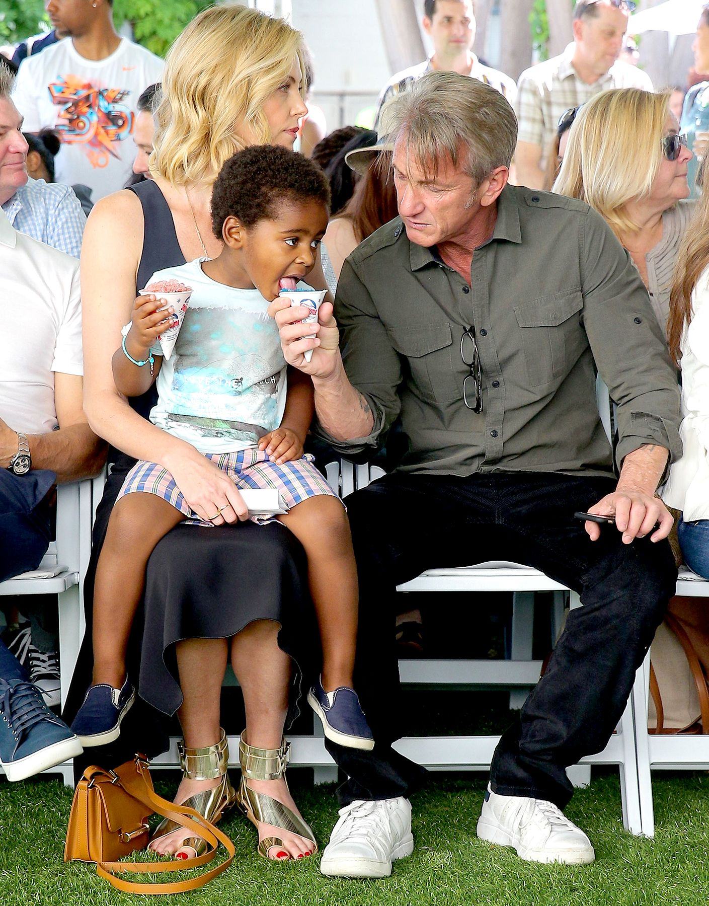 Aww Sean Penn Shares His Snow Cone With Charlize Therons Son