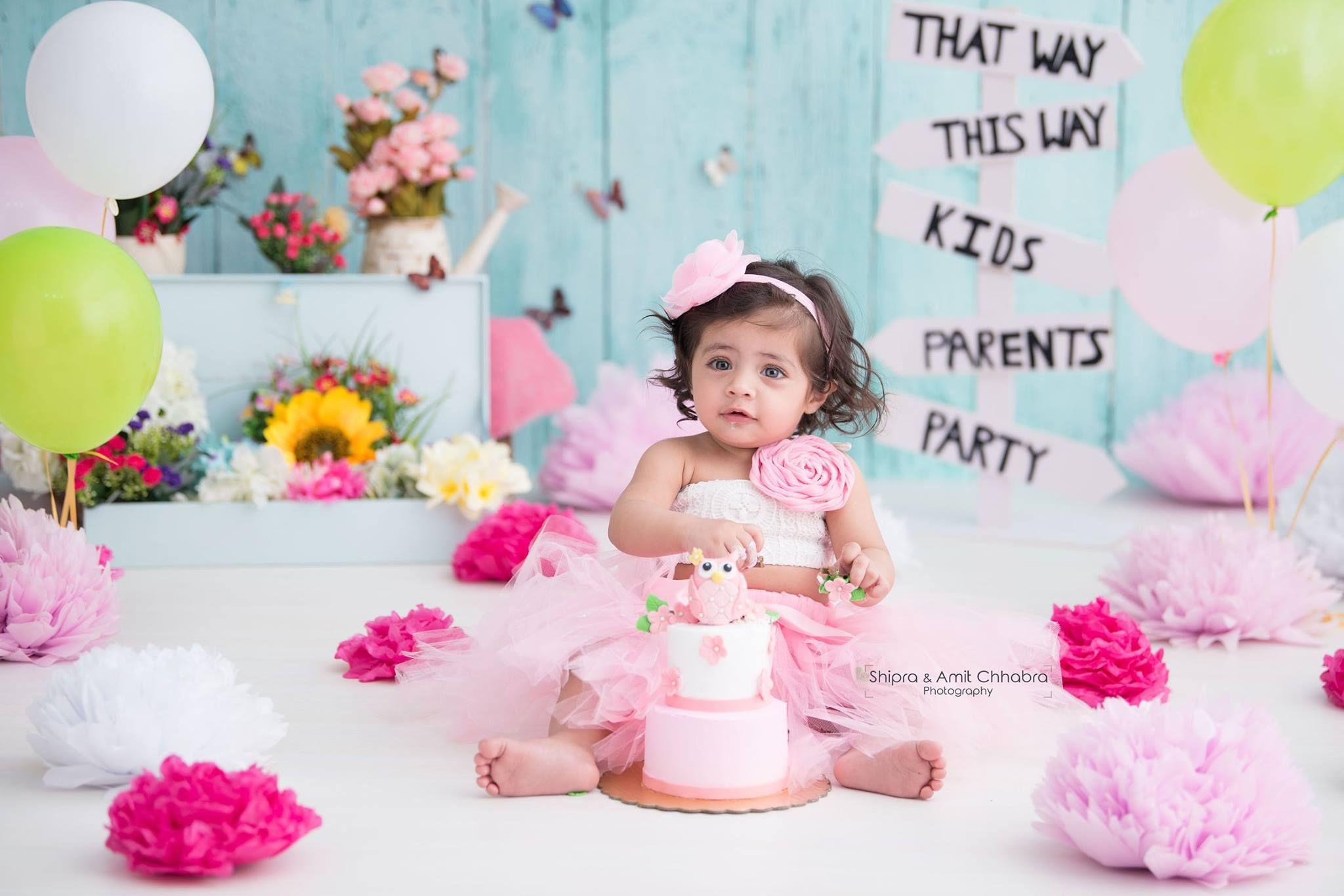 Girl cake smash photoshoot pink cake for birthday floral theme set up kids photography shipra amit chhabra photography delhi ncr