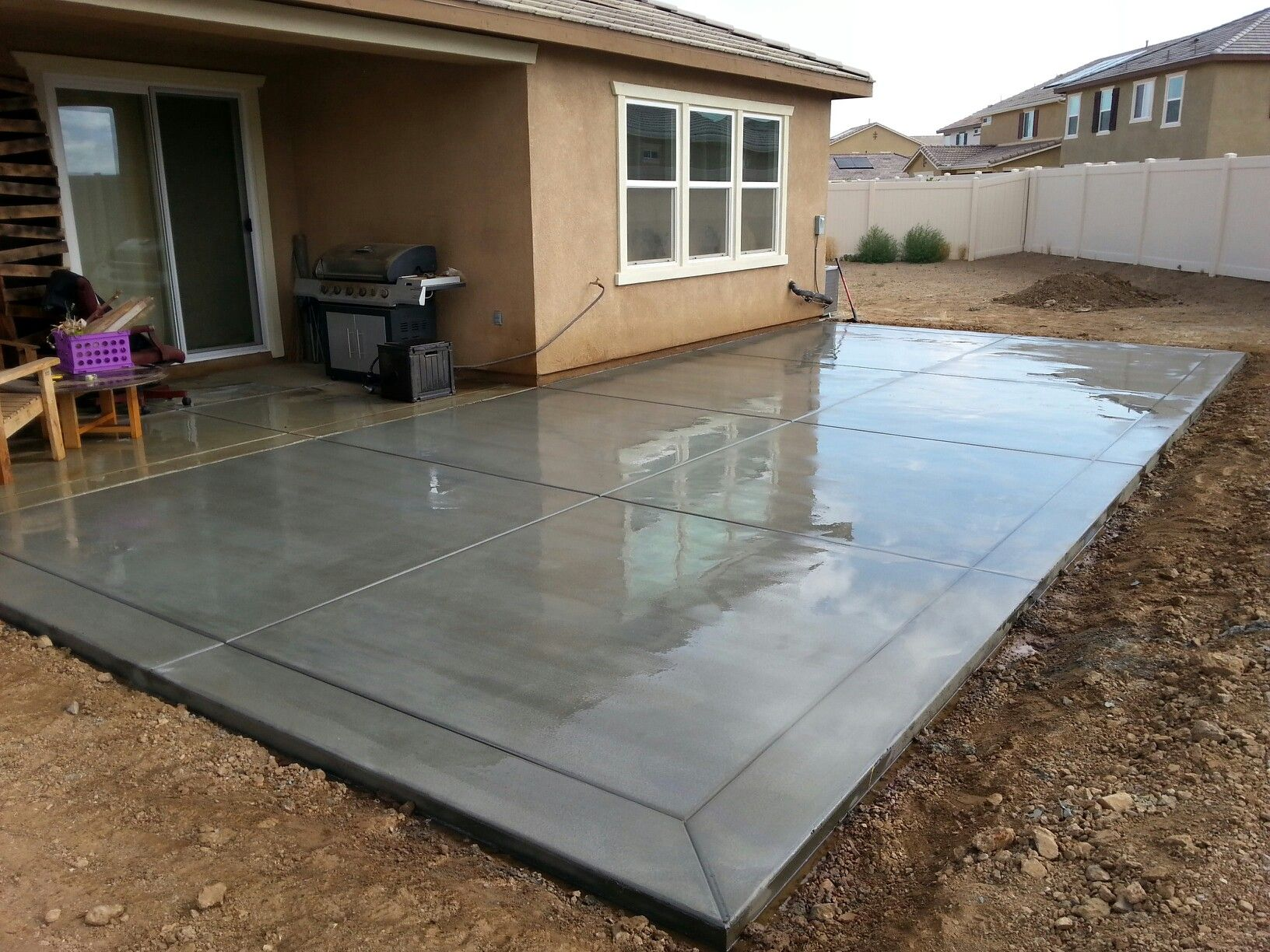 Broom finish concrete patio slab with 12 border bands for Latest patio designs