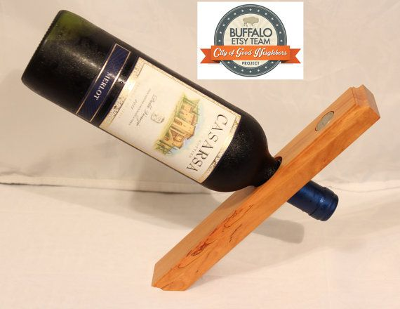 This eye catching and head scratching cherry wine holder gives the illusion of falling while actually holding a bottle of wine at a 45 degree angle.