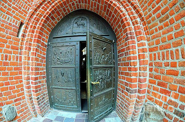 Poland, Bydgoszcz; The St. Martin and St. Nicholas Cathedral entrance door designed by sculptor Michal Kubiak, 2003.