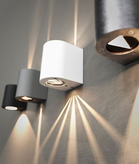 very funky filtered wall lights in five finishes