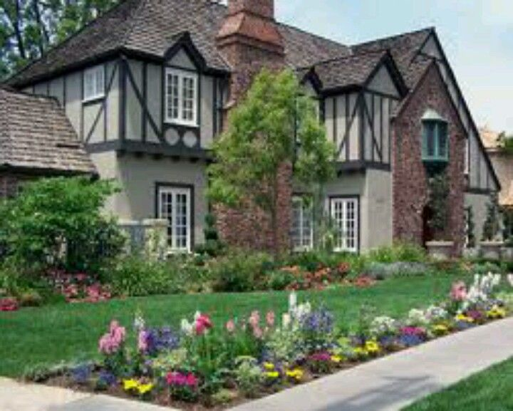 english tudor with trees and flowers
