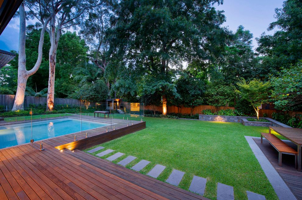 Semi inground pool landscape contemporary with backyard for Landscape gardeners poole